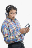 Man listening to music and whistling — Stock Photo