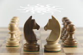 Chess knights face to face — Stock Photo
