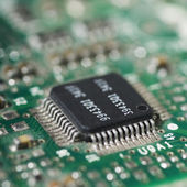 Computer chip on a circuit board — Stock Photo