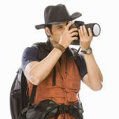 Photographer photographing with a digital camera — Stock Photo