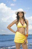 Female fashion model on the beach — Stock Photo