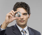 Businessman looking at a crystal ball — Stock Photo