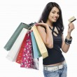 Woman holding shopping bags and a credit card — Stock Photo #32960183