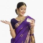 Assamese woman holding a credit card — Stock Photo #32969477