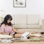 Woman reading magazines — Stock Photo