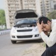 Businessman after his vehicle breakdown — Stock Photo