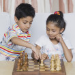Boy and a girl playing chess — Stock Photo
