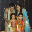 Stock Photo: Family celebrating Diwali festival