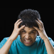 Frustrated man holding his head — Stock Photo #32968679