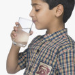 Schoolboy drinking glass of water — Stock Photo #32969031