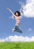 Woman jumping in a field — Stock Photo