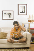 Man playing video game in the living room — Stock Photo