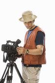 Videographer adjusting a videography camera — Stock Photo