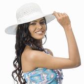 Woman wearing white hat — Stock Photo