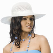 Woman wearing white hat — Stock Photo