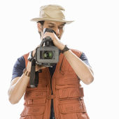 Videographer holding a videography camera — Stock Photo