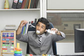Businessman behaving like a kid in an office — Stock Photo