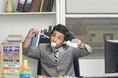 Businessman behaving like a kid in an office — Stock Photo