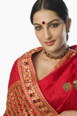Woman in bright red mekhla — Stock Photo