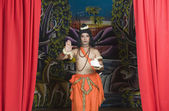 Artist dressed-up as Rama blessing — Stock Photo