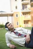 Businessman listening to music — Stock Photo