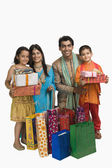 Family holding shopping bags and gifts for Diwali — Foto de Stock