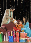 Couple giving gifts to their son on Diwali festival — Stock Photo