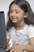 Girl using a laptop — Stock Photo