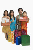 Family holding shopping bags and gifts for Diwali — Stock Photo