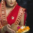 Woman in sari holding religious offering — Stock Photo