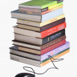 Stock Photo: Stack of books and a computer mouse