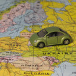 Toy car on the world map — Stock Photo