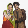 Sikh couple taking picture of themselves — Stock Photo #32976001