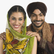 Sikh couple smiling — Stock Photo #32977571