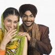 Sikh couple smiling — Stock Photo #32979681