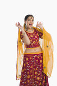 Woman dancing in bright red lehenga choli — Stock Photo