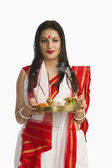 Woman in a Bengali sari holding puja thali — Stock Photo