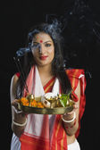 Woman holding puja thali — Stock Photo