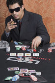 Man at a casino table — Stock Photo