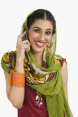 Sikh woman talking on a mobile phone — Stock Photo