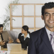 Businessman with his colleagues — Stock Photo