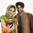 Stock Photo: Sikh couple taking picture of themselves
