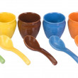 Assorted ceramic containers and soup spoons — Stock Photo #32983437