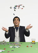 Man tossing gambling chips in a casino — Stock Photo
