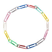Assorted paper clips arranged in a circular shape — Stock Photo