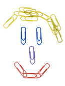 Paper clips arranged in a smiley face — Stock Photo