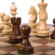 Chess pieces on chessboard — Stock Photo #32990869