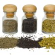 Close-up of spice containers with spilled spices — Stock Photo #32990929
