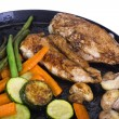 Stock Photo: Chicken breasts with vegetable on griddle