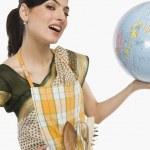 Woman holding a globe — Stock Photo #32999441